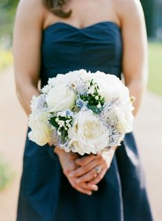 A lovely bouquet of white and blue blossoms to go with a navy bridesmaids dress.  photography by http://www.msp-photography.com/