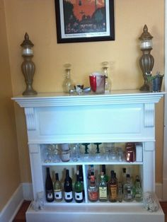an old mantel became our new bar with my idea & scotts elbow grease from a fake fireplace to a display 4 firewater