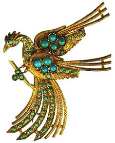 22kt Gold brooch of a bird with outstreched wings and small round turquoise beads.Persian Brooch,  200 BC.