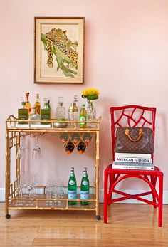 I love the cheetah art with touches of green. Goes perfectly with the wonderful red chair. LV doesn't hurt, either :)