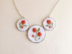 Embroidered floral necklace with silver toned findings