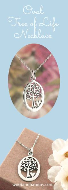 Oval tree of life necklace with tiny heart in sterling silver.