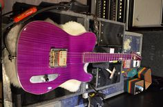 The Guitars of Billy Gibbons | Tone Report a  Favourite purple Bolin Guitars neck-thru, mahogany-maple Tele-shape with checkerboard binding, a Cream T Pickups Billy F. Gibbons Banger (customized with purple leds), single-piece aluminum Bolin bridge plate, and Glendale saddles.