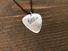 Music notes silver guitar pick Custom Guitar Pick Music | Etsy Custom Guitar Picks, Music Notes, Rock Music, Music Instruments, Unique Jewelry, Handmade Gifts, Silver, Etsy, Kid Craft Gifts