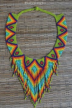 **If you like to stand out** and at the same time appreciate the intricate craftsmanship and workload during the creative process **luloplanet has something special for you **- indigenous. Diy Necklace Patterns, Beaded Jewelry Patterns, Beading Patterns, African Beads Necklace, Beaded Choker Necklace, Flower Necklace, Necklaces, Native Beadwork, Mexican Jewelry