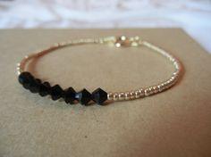 Black Swarovski Bead & Gold Seed Bead Bracelet by LoveAndGold, $15.00