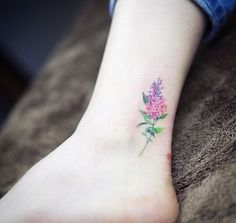 What does lilac tattoo mean? We have lilac tattoo ideas, designs, symbolism and we explain the meaning behind the tattoo. Pretty Tattoos, Love Tattoos, Beautiful Tattoos, Body Art Tattoos, Tattoos For Women, Tatoos, Nature Tattoos, Sunflower Tattoo Small, Small Flower Tattoos