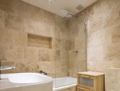 A bathroom with travertine tiles and mosaics on the shower walls and floors Travertine Bathroom, Natural Stone Bathroom, Bathroom Tiling, Bathroom Storage, Bathroom Renos, Bathroom Renovations, Small Bathroom, Earthy Bathroom, Bathroom Ideas