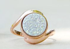 Gorgeous,natural druzy quartz gemstone are bezel set on rose gold plated 925 sterling silver band.
