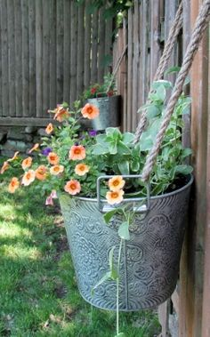 Hanging Plants On Fence, Hanging Planters Outdoor, Fence Planters, Hanging Flower Baskets, Hanging Pots, Flower Planters, Flower Fence, Flower Beds, Flower Wall