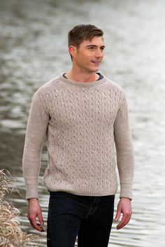 """Handsome! It's not often we get to show unisex garments being modelled by a man! The Wishbone Sweater is a fresh example of a pullover for the rugged yet classy man or woman in your life. (Feel free to substitute """"cute yet nerdy"""", """"sweet yet saucy"""", """"kind yet hilarious"""" etc, as you see fit). Allison Jane designed a gorgeous sweater in Acadia in the color Sand. It features wishbone cables up the front and rope cables at the sides for subtle interest. The back and sleeves are…"""