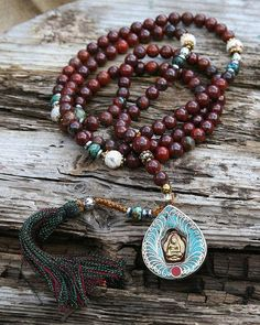 Mala made ​​of 108, 8 mm - 0,315 inch, beautiful Jasper gemstones and decorated with Turquoise, faceted Agate and a handmade Nepalese Buddha pendant - Made by look4treasures