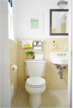 """Love the small tiles on the floor, the """"tiled"""" toilet paper holder and toothbrush holder. Retro!"""