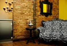 One of the top 10 best budget hotels in New York. That is one rockin' couch and it looks amazing against the brick.