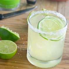 Classic Lime Margarita - Served on the rocks with a squeeze of lime and, of course, a salted rim.