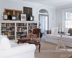 Like=the layered art on top of shelves & the random way the books are in the shelves. The visual clutter is offset by the white walls, slipcovers & light rug. Nice, personal, comfortable, eclectic.