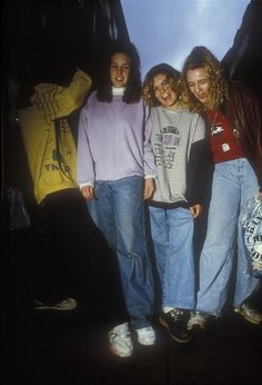 Girls in oversized clothes showing their jeans, Manchester 1990s