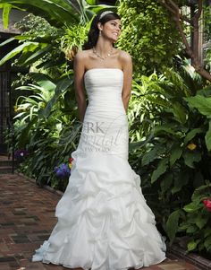 RK Bridal - Sincerity Bridal Spring 2013- Style 3742  A strapless straight across neckline has a asymmetric dropped waist done in draped organza complements this soft pickup mermaid gown. Fabric buttons cover the back zipper and this style has a chapel length train