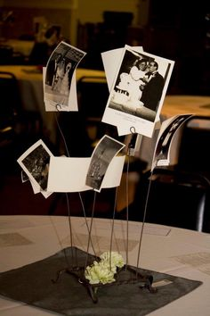 Each table had different old wedding pictures from our families (with titles of who family they were bride and groom). Included all our ancestors as many wedding photos we could find. Guests lived it, they got to take pictures along with homemade centerpiece home.