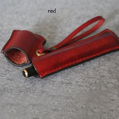 Welcome to my shop! All the items are desiged and handmade by myself.The Goods are made of genuine cow leather.They wil age and turn beautifully .  Hand Stitched Red Leather Pencil Case Its a simple sleeve design and really easy to use. The design of remodeling the case is very particular and novelty. We can stamp your name or logo let the case be your unique one! Hope you will like it,it will be a unique gifts for yourself or your friends. Material: 100% genuine cow leather  Measurement…