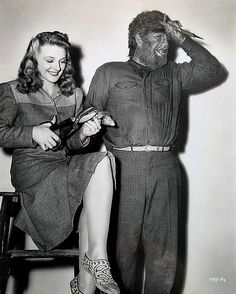 """Evelyn Ankers gives Lon Chaney Jr. a manicure on the set of """"The Wolfman"""" - 1941"""