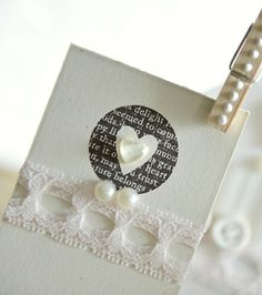 Stamped heart using Papertrey Ink Love Lives Here stamps, with Smokey Shadow ink. Sparkly heart added to the center, along with a strip of lace, some pearls, and a liquid pearl dotted clothes pin.