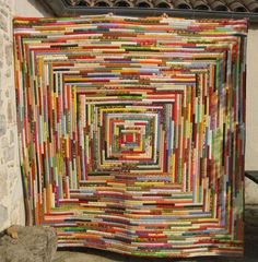 Log Cabin variation, done in brights. Another French quilt. Use salvages