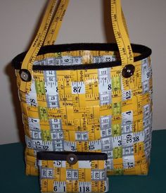AWESOME measuring tape woven bag.  SO cool!!  I've never come across enough cheap measuring tapes to do this yet.