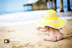 Beach, waves, chubby cheeks, and big yellow hat= Awesomeness !