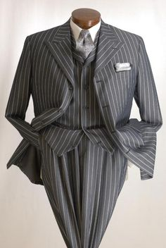 3 piece grey pin stripe suit. How swimmingly delightful! And how inquisitive and intoxicating the images are.