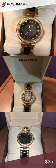 Women's Armitron Relic Watch Two toned, black and gold band with diamonds around face. Armitron Jewelry