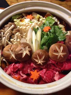 Sukiyaki. I wonder what the little things with the x's are...they look yummy ^u^