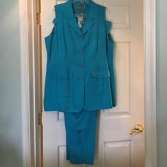 Turquoise tunic & pants set Long sleeveless button tunic with deep pockets & matching zip w/elastic pants. Great for special occasions! Can add a jacket or wrap for cooler temps! Raw natural silk; gorgeous color & fabric!! Dry clean. Lane Bryant Tops Tunics