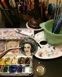 Former Queen Anne-Marie.  She was born in 30 August 1946 and she is the wife of King Constantine II, who reigned from 1964 until 1973.  Queen Anne-Marie Illustration Bronze pendant Using Winsor&Newton cotman paper, watercolors and white stabilo carbothello