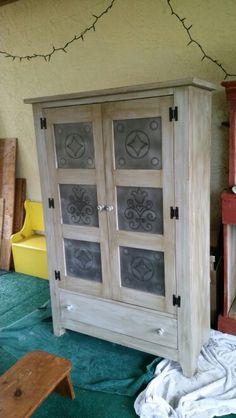 Pie safe all done.  Grey chalk paint  Dark gloss coat Distressed