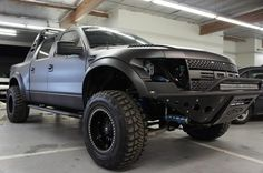 Custom Ford Raptor... Sweet Jesus I want this exact one with this matte black paint job ummm yes