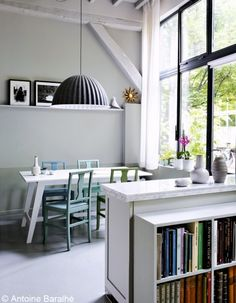 love this space! beams, huge pendant light & different colour chairs
