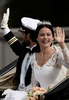 Newlyweds: Princess Sofia waves as they ride away from the chapel...