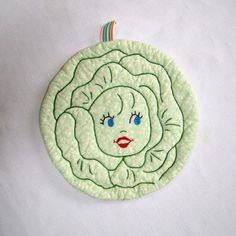 I love that someone took a vintage iron-on transfer and made it into a cute potholder.  I'll have to do this someday!