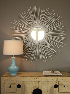 How To: http://www.hgtv.com/living-rooms/create-a-sunburst-mirror/index.html