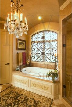 Tuscan bathroom design. Love the iron work over the window an  tub surround. Remodel ideas.
