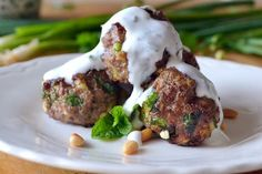 Lebanese Meatballs ~ you can't help but fall in love with these tender beef and lamb meatballs made with tons of fresh herbs, spices, and tangy goat cheese!