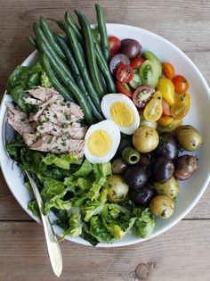 Salad Nicoise (Summertime in France  - The Jewels of New York). This is great with fresh seared tuna and soft boiled eggs as well.
