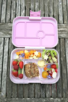 Yumbox lunch with a roll, roast beef slices wrapped in romaine lettuce leaves, tomatoes, radishes, kiwi strawberries and raspberries, cheddar cheese cubes and mayo for dipping.