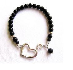 Heart bracelet. Sterling Silver Hammered Heart and Onyx by NetaPam