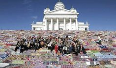 """From the Manos Del Uruguay Blog: """"We leave you with some pictures of this spectacular yarnbombing that took place last January on the steps of Helsinki Cathedral in Finland. It was covered by 7800 crochet blankets which were then donated to shelters. Simply Brilliant!"""""""