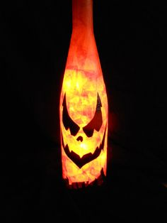 Holiday wine bottle lights Jack O lantern by CharmingAffect, etsy - great idea!