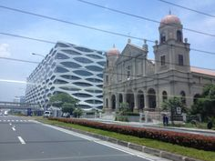 A photo I took during my visit back to Manila this summer. The two buildings automatically caught my attention because I found it interesting that these buildings were side-by-side. It seem to portray the nation's desire to move forward, but a stronger desire to protect its heritage. Several large modern buildings, such as the Mall of Asia, surround this church; I found it amazing that this church remain untouched.