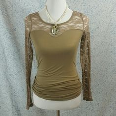Rue 21 Top Stretchy elastic lace. Color is a little more of a tan brown then what is shown. Rue 21 Tops