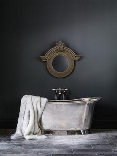 Using sumptuous accessories like fur throws creates hygge in any bathroom - this is the Nickel Bateau by Catchpole and Rye #interiordesign